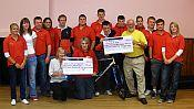 Raughton Head YFC with the charity cheques